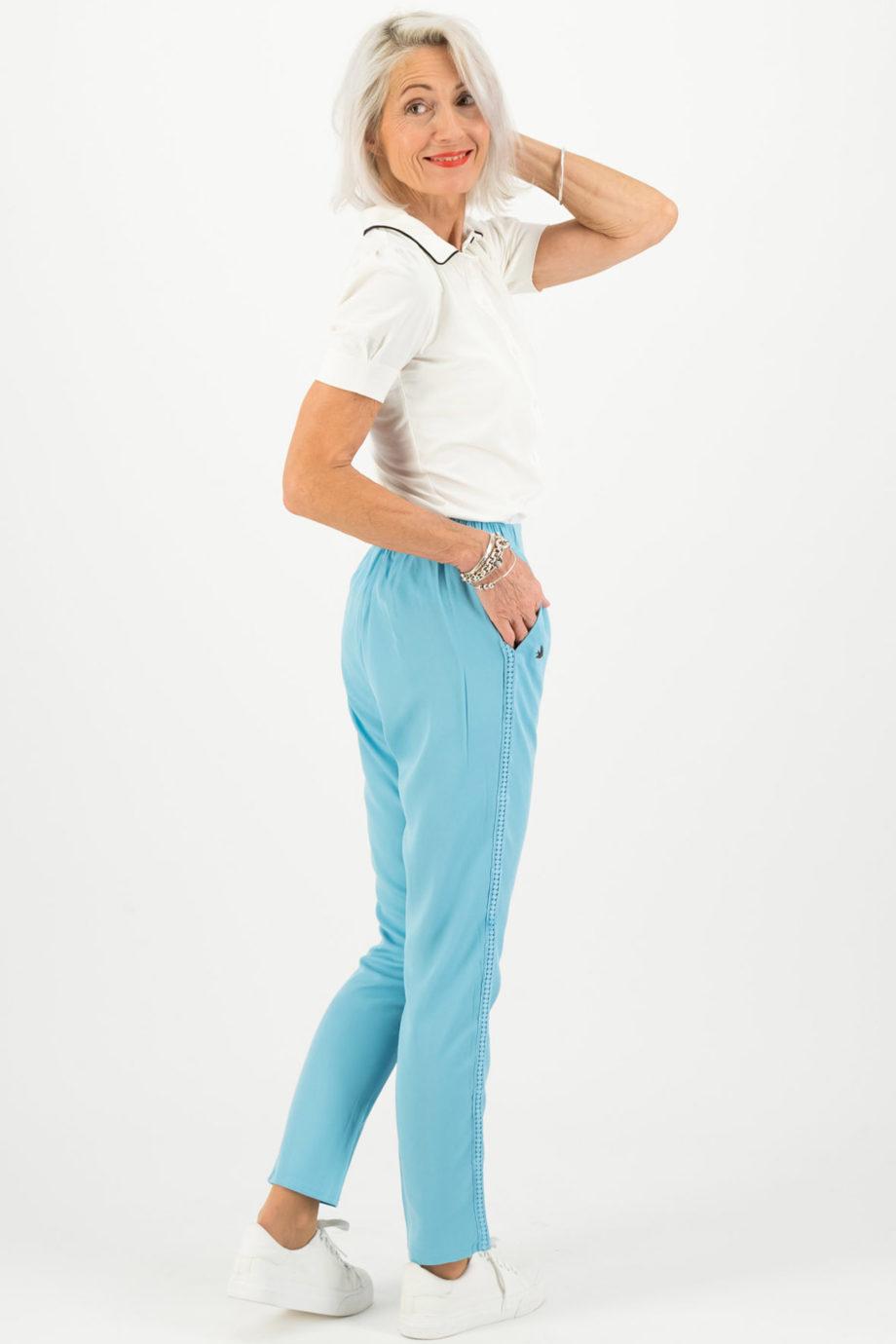 blutsgeschwister pantalon logo azul espalda